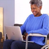 senior woman with laptop smiling