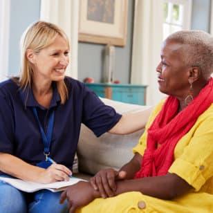 caregiver talking to her senior patient
