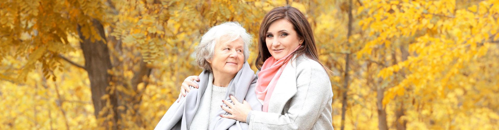 senior woman looking at the smiling caregiver