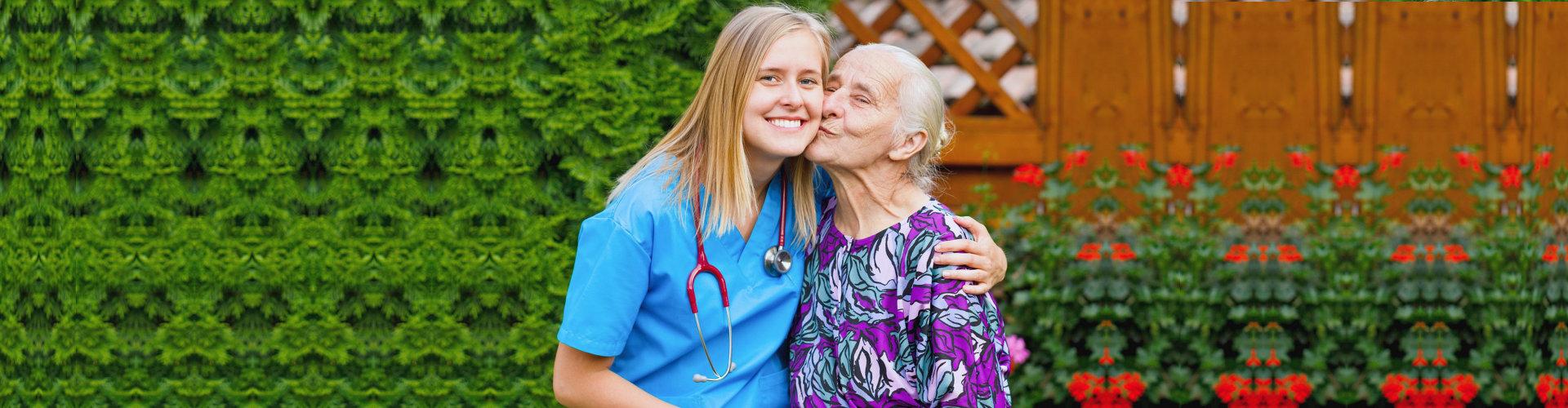 senior woman kissing her nurse